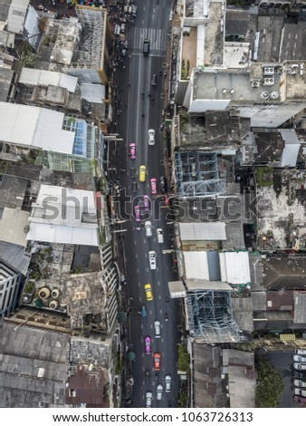 Aerial drone photograph of traffic jam in metropolis city. #1063726313