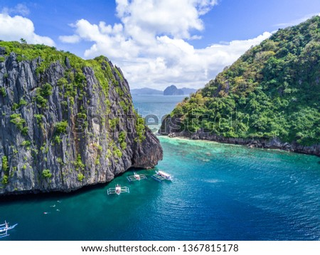 Aerial Drone Picture of limestone islands and crystal clear water in El Nido, Palawan in the Philippines