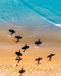 Aerial drone reef ocean waves surfers vacation tropical island photo
