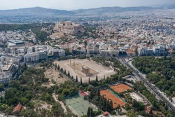 Aerial drone shot of Acropoli of Athens, museum and Zeus Olympion Temple collumn ruins