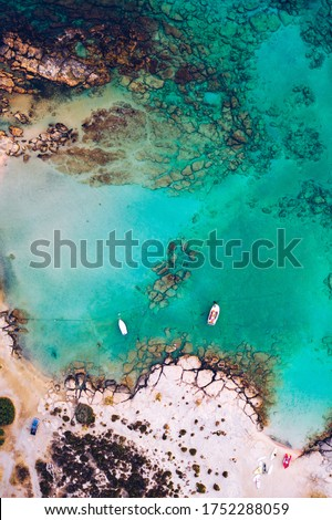 Aerial drone shot of beautiful turquoise beach with pink sand Elafonissi, Crete, Greece. Best beaches of Mediterranean, Elafonissi beach, Crete, Greece. Famous Elafonisi beach on Greece island, Crete.