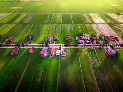 aerial drone shot of house on paddy field.Soft focus due to long exposure shot. Nature composition.Noise and grain due to long exposure shot