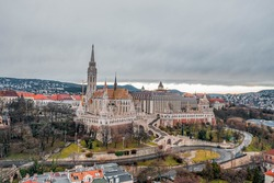 Aerial drone shot of Matthias Church on Buda hill during Budapest before sunrise in winter morning