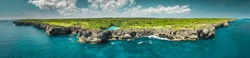 Aerial drone shot of panorama island in Indian ocean. Indonesia. Spectacular view above Sumba island the plain with greens and pure lakes on the blue cloudy sky background. Travel, holiday, recreation