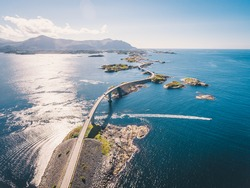 """Aerial drone shot of the world famous Atlantic Road is known as """"The Road in the Ocean"""" in Norway. This fantastic and spectacular road and bridge is a very popular tourist attraction."""