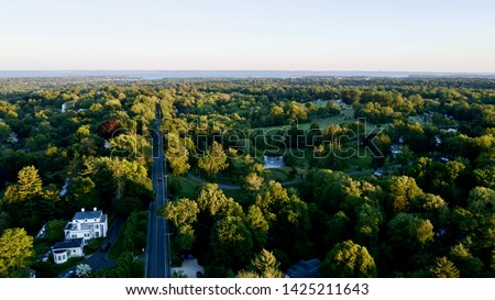 aerial drone shot over by North Street in Greenwich, Connecticut, looking towards the Long Island Sound Сток-фото ©