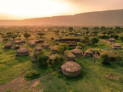 Aerial Drone Shot. Traditional Masai village at Sunset time near Arusha, Tanzania