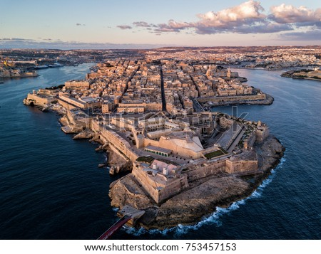 Aerial drone sunrise photo - Ancient capital city of Valletta Malta.  Island Country of Europe in the Mediterranean Sea