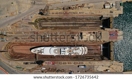 Photo of  Aerial drone top down photo of shipyard repairing large yacht and restoring sea damage