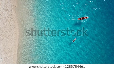 Aerial drone top view photo of exotic island with deep turquoise and emerald open ocean sea