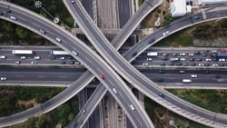 Aerial drone top view photo of highway multilevel junction interchange road in urban populated area