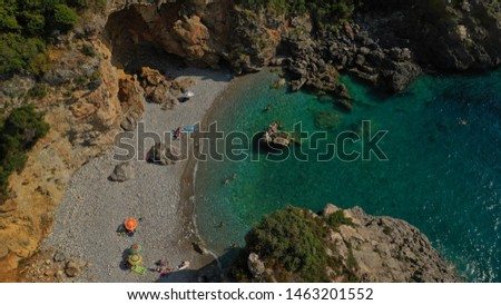 Aerial drone top view photo of iconic pebble beach of Foneas in the heart of Messinian Mani, Peloponnese, Greece