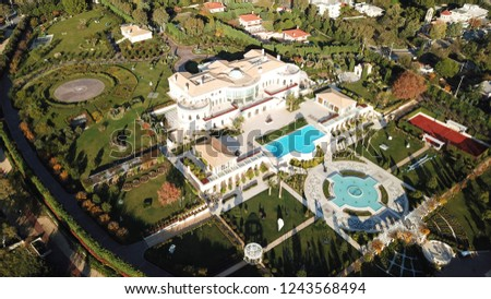 Aerial drone top view photo of pool and fountain found in tropical destination luxury villa #1243568494