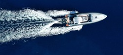 Aerial drone top view ultra wide photo of luxury inflatable rib speed boat cruising in mediterranean deep blue sea