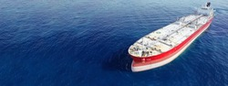 Aerial drone ultra wide panoramic photo of huge crude oil tanker anchored in open ocean deep blue sea