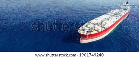 Aerial drone ultra wide panoramic photo of huge crude oil tanker anchored in open ocean deep blue sea Stockfoto ©