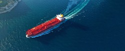 Aerial drone ultra wide panoramic photo of industrial crude oil - fuel and petrochemical tanker cruising open ocean deep blue sea