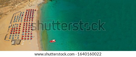 Aerial drone ultra wide photo of famous beach of Lia in island of Mykonos, Cyclades, Greece Foto stock ©