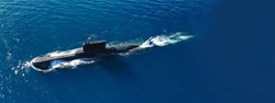 Aerial drone ultra wide photo of latest technology naval armed forces submarine cruising in deep blue open ocean sea