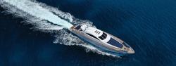Aerial drone ultra wide photo of luxury yacht cruising in deep blue sea near Mediterranean Aegean island