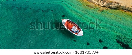 Aerial drone ultra wide photo of traditional fishing boat cruising in small Cycladic island of Schinoussa, Aegean Sea, Greece Foto d'archivio ©