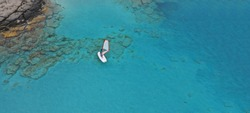Aerial drone ultra wide photo of wind surfers practising in turquoise exotic paradise sandy bay