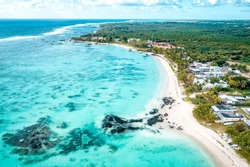 Aerial drone view at luxury resorts and coastline at Belle Mare beach on island Mauritius. Toned image.