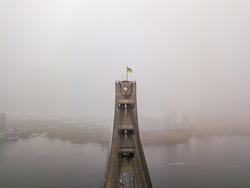 Aerial drone view. Flag of Ukraine on the North Bridge in Kiev.
