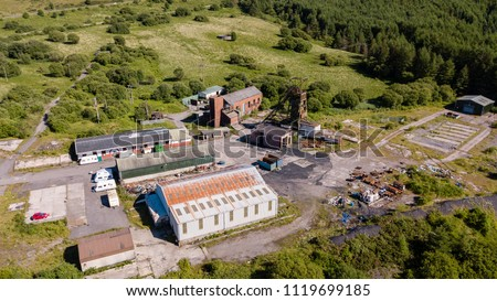 Aerial drone view of a closed, abandoned coal mine (Tower Colliery, South Wales)