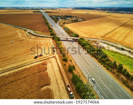 Aerial drone view of beautiful French countryside and six-lane motorway in Brittany, France Stock photo ©