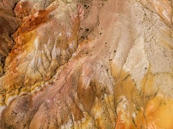 Aerial drone view of colorful eroded landform of Altai mountains with yellow, brown and red colors. Nature landscape in popular tourist location called Mars, near the border with Mongolia, Chagan-Uzun
