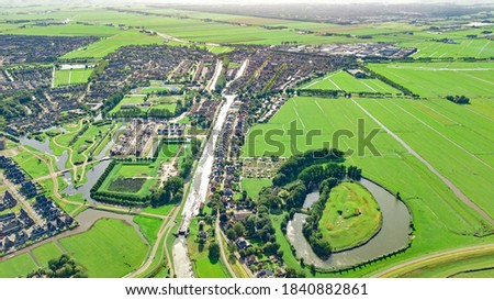 Aerial drone view of Edam town cityscape from above, typical Dutch city skyline with canals, houses and marina, Holland, Netherlands