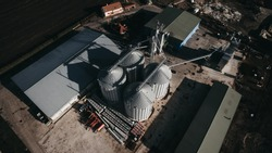 Aerial drone view of Grain Milling Company In Hungary. Agriculture granery business industry.