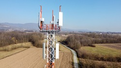 Aerial drone view of GSM and radio telecommunication tower. Cell phone tower. Base transceiver station. Wireless communication antenna transmitter.