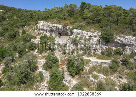 Aerial drone view of hideout of Tito's Cave on Josip Broz on Vis Island in Croatia summer Stock fotó ©