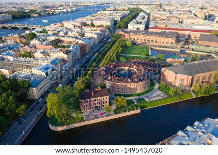 Aerial drone view of historical city part with old architecture and modern park between two artificial river channel, round building in the center, new Holland, Saint Petersburg, Russia #1495437020