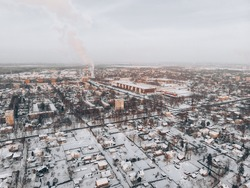 aerial drone view of houses and road. winter landscape.
