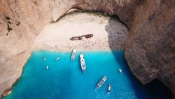 Aerial drone view of iconic beach of Navagio or Shipwreck one of the most beautiful beaches in the world with deep turquoise clear sea, Zakynthos island, Ionian islands, Greece