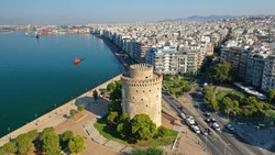 Aerial drone view of iconic historic landmark - old byzantine White Tower of Thessaloniki or Salonica, North Greece