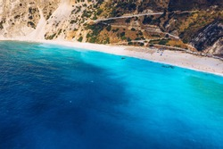 Aerial drone view of iconic turquoise and sapphire bay and beach of Myrtos, Kefalonia (Cephalonia) island, Ionian, Greece. Myrtos beach, Kefalonia island, Greece. Beautiful view of Myrtos beach.