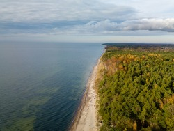 Aerial drone view of Karkle, Lithuania baltic sea beach coast line near famous tourist attraction spot The Dutchman's Cap