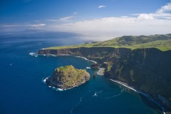 Aerial drone view of landscapes in Flores, Azores, Portugal. Corvo island in the background