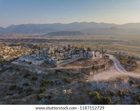 Aerial drone view of Lekuresi Castle located in Saranda, Vlora, Albania (South Albania)