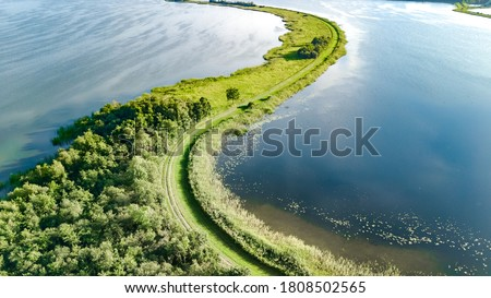 Aerial drone view of path on dam in polder water from above, landscape and nature of North Holland, Netherlands  Stok fotoğraf ©
