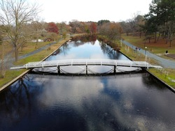 Aerial drone view of Salisbury city park bridge and lake Salisbury Maryland Fall 2020