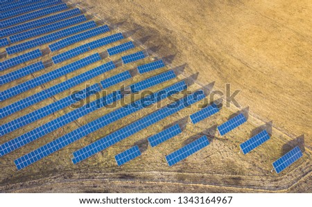 Aerial drone view of solar panels at a solar energy farm. Vilnius county, Lithuania #1343164967