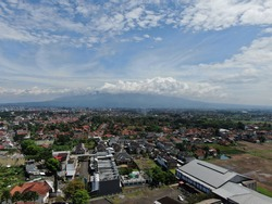 Aerial drone view of Tasikmalaya city with cloudy weather, West Java, Indonesia