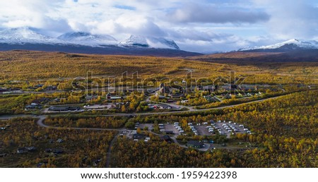 Aerial drone view of the Abisko town, in middle of foliage nature, on a sunny autumn day, in Lappland, Norrbotten, Sweden Stock foto ©