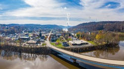 Aerial drone view of the city of Point Marion in Pennsylvania with Fort Martin coal powered power station in the background