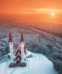 Aerial drone view of the famous landmark of Ufa and Bashkortostan - Lala Tulip mosque during sunset in winter season. Islamic religion and muslim culture in Russia concept